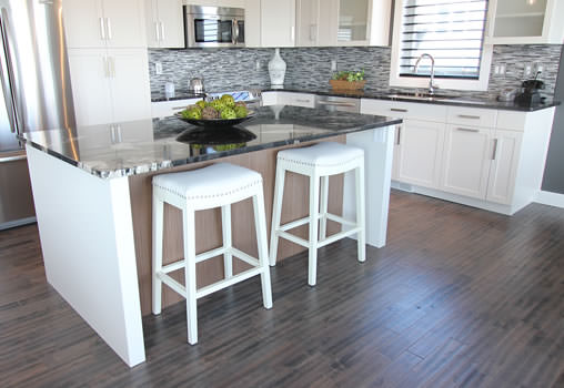 A new bright kitchen, in Saskatoon, with dark hardwood flooring
